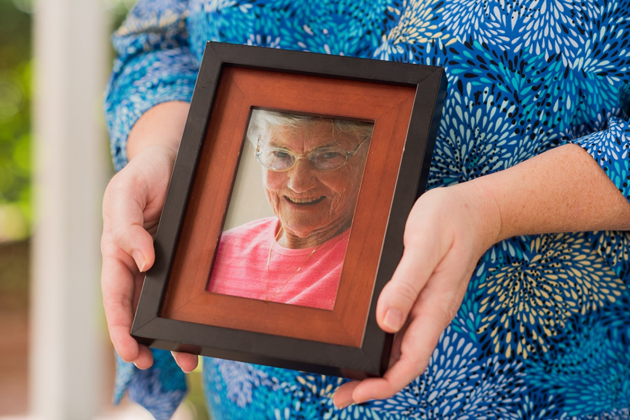 Stephanie-Weaver-holds-a-photo-of-her-grandmother-Bonnie-Walker.-Weaver-is-suing-Brookdale-Charleston-for-emaotional-distress-folowing-Walker-s-death-in-a-pond-behind-the-assisted-living-facility-in-2016.-Leigh-We
